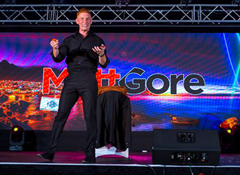 Comedy entertainer Matt Gore performing on stage