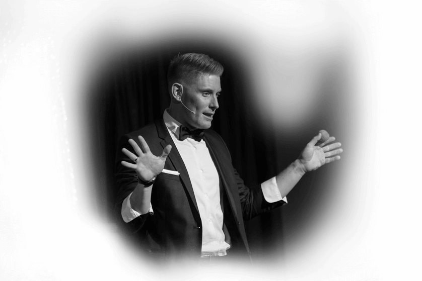 Black and white image of Matt Gore the magician on stage