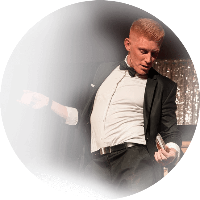 Event entertainer and magician Matt Gore performing on stage