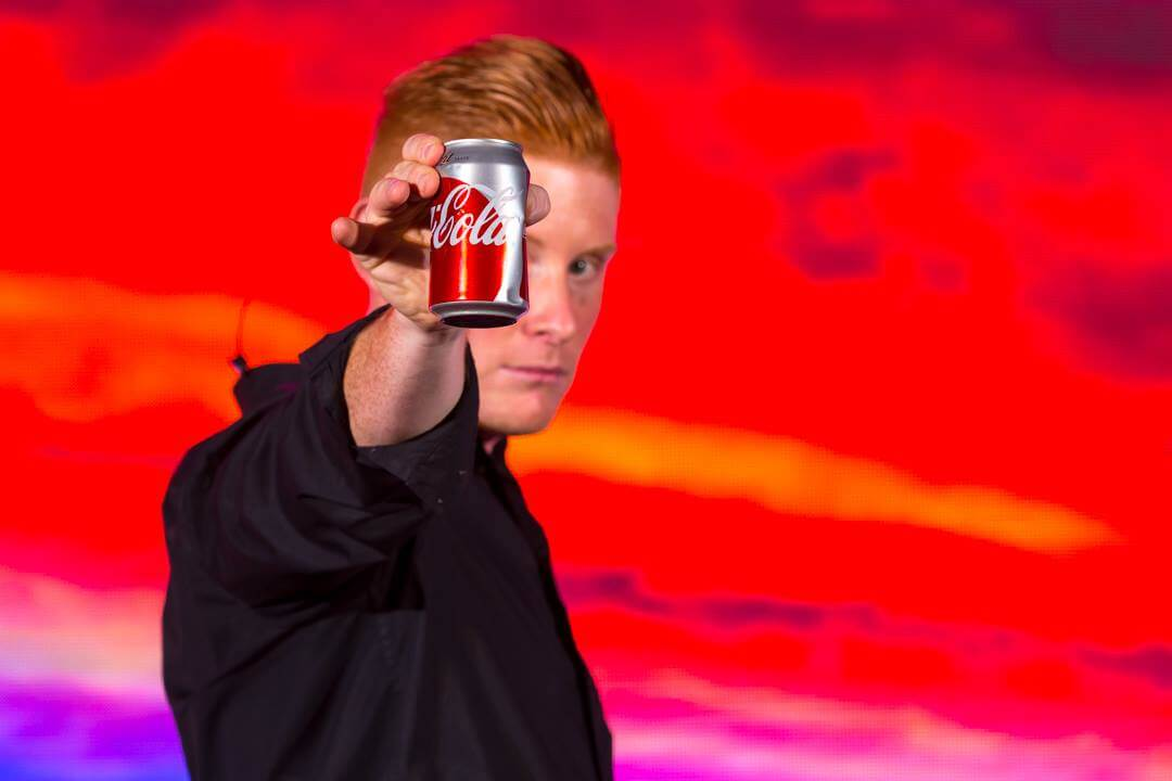 Matt Gore performing with Coca Cola can
